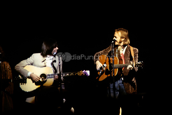 Neil Young & Steven Stills of Crosby, Stills, Nash & Young performing on their '4 Way Street' tour at the Boston Garden in Boston, MA on May 29,  1970.<br /> © Peter Tarnoff / MediaPunch