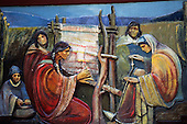 Buenos Aires, Argentina. Painting of Mapuche Indians with weaving loom, one spinning cotton on a spindle.
