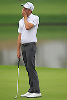 Chris Kirk (USA) misses his putt on the 11th green during Friday's Round 2 of the 2014 BMW Masters held at Lake Malaren, Shanghai, China 31st October 2014.<br /> Picture: Eoin Clarke www.golffile.ie