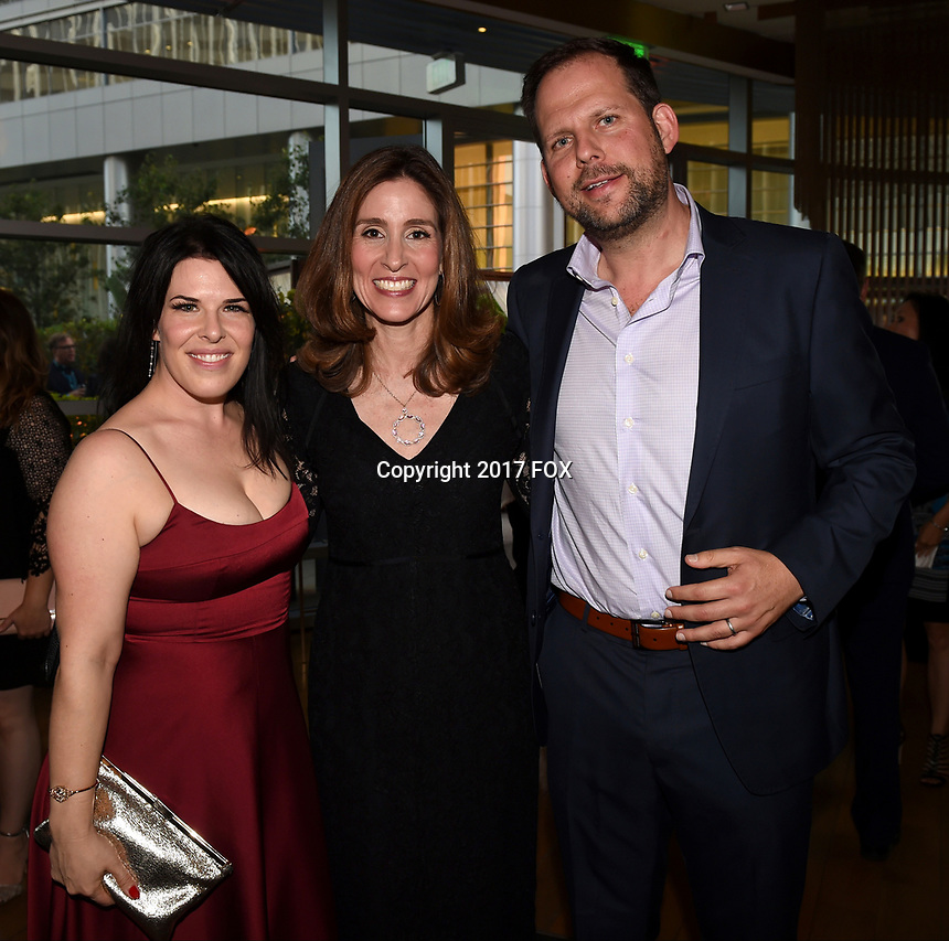 LOS ANGELES, CA - SEPTEMBER 16: (L-R) Alexis Martin Woodall, Carolyn G. Bernstein and Nick Grad attend the FX Networks and Vanity Fair 2017 Primetime Emmy Nominee Celebration at Craft LA on September 16, 2017 in Los Angeles, California. (Photo by Frank Micelotta/FX/PictureGroup)