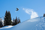 Professional Snowboarder Romain de Marchi spins through the air deep in the Coast Mountains of British Columbia, while filming for his part in the upcoming Absinthe Films production.