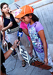 AJ Alexander -  Katharine Figueroa crying during an interview at the Children March in protest against Sheriff Joe Arpaio arressting Illeagal undocumented workers in this  county. From the county jail on 4th ave to Wells Fargo Bank on Friday August 7, 2009.  Photo by AJ Alexander
