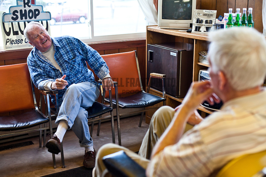 Vincent Moriarty talks with John Murray at Murray's Barbershop. Moriarty comes to visit because he has a grandchild close by that he sees in the afternoons. The two gentleman often tease each other, talk about current events and recount past times.