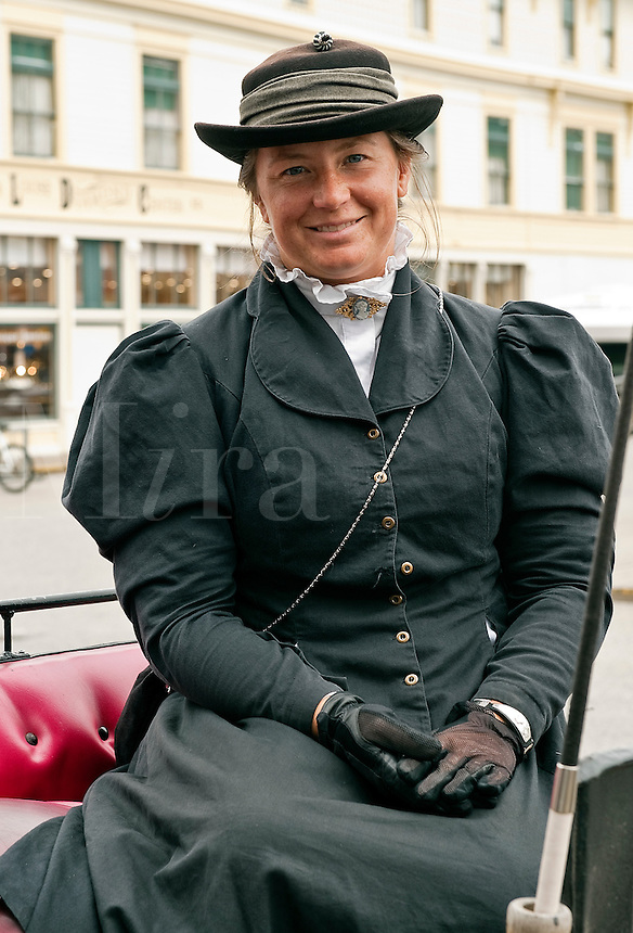 Friendly horse and buggy tour guide in period costume, Skagway, AK, Alaska