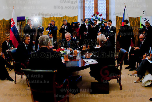 Presidents of Visegrad countries (V4), Pal Schmitt (L) of Hungary, Bronislaw Komorowski (2nd L) of Poland, Ivan Gasparovic (2nd R) of Slovakia, and Vaclav Klaus (R) of Czech Republic talk during their summit in Visegrad, 55 km (34.2 miles) north of Visegrad, Hungary on October 08, 2011. ATTILA VOLGYI