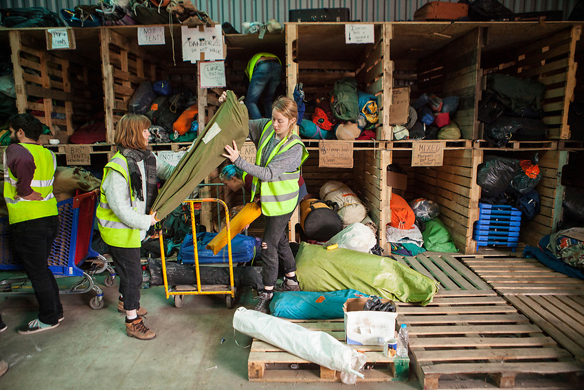 """Help Refugeess UK Volunteers sorting the donated tents at the warehouse in Calais which will then be gven to new arrival refugees at """"The Jungle"""" refugee camp in Calais. Help Refugees has grown out of #helpcalais, a social media campaign started by Lliana Bird (Radio X DJ), Dawn O'Porter (Writer and Presenter), Josie Naughton and Heydon Prowse (The Revolution will be Televised) to raise a few funds and collect goods to take to Calais to help in some small way. The public response to the campaign was huge, and we were quickly able to provide aid in Calais and far beyond."""