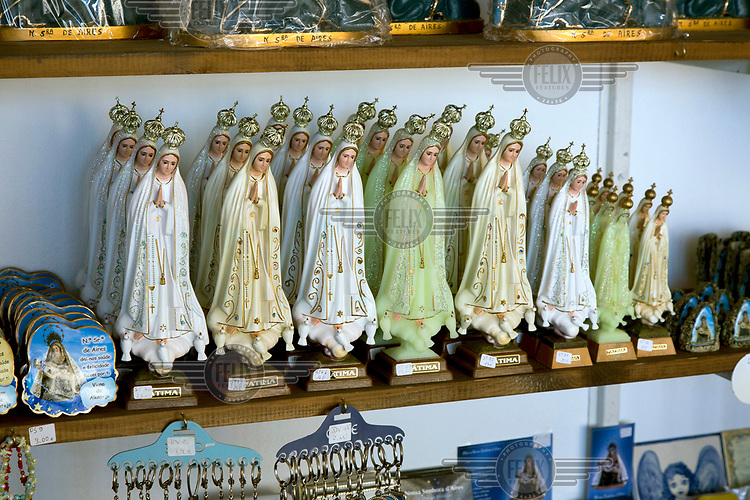 Statuettes of Our Lady of Fatima for sale in a souvenir shop at the place of pilgrimage for Nossa Senhora de Aires.