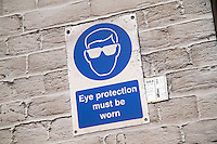 Eye protection sign inside a farm workshop