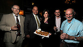 drinks reception, Oil and Gas Decommissioning Conference, Dunblane Hydro - Hotel staff member Charlotte Stewart (centre) serves some Haggis snacks to - l to r - Rob Seaton, Brendan Hynes, Nigel Lees, and Ian Roach - 6.10.10 - picture by Donald MacLeod - mobile 07702 319 738 - clanmacleod@btinternet.com - www.donald-macleod.com