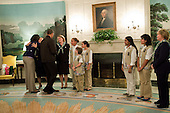 Washington, DC - October 7, 2009 -- United States President Barack Obama and First Lady Michelle Obama greet members of the Girl Scouts including Connie Lindsey, Chair of the National Board of Directors, left, Sharon Pearce, Director of Public Policy, second from left, and Kathy Cloninger, CEO, right, in the Diplomatic Reception Room of the White House, October 7, 2009.  .Mandatory Credit: Samantha Appleton - White House via CNP