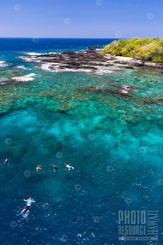 Tourists snorkel in the clear waters of Kealakekua Bay, Big Island.