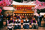 Japanese men in kimono in front of their float in Yayoi festival. Yayoi festival takes place during the month of April in the Futarasan shrine in Nikko to celebrate the arrival of spring. <br />