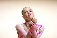 Marina Shpekt of Russia with eyes closed during finish of her ribbon routine during All-Around competition at 2006 Thiais Grand Prix in Paris, France on March 25, 2006.  (Photo by Tom Theobald)