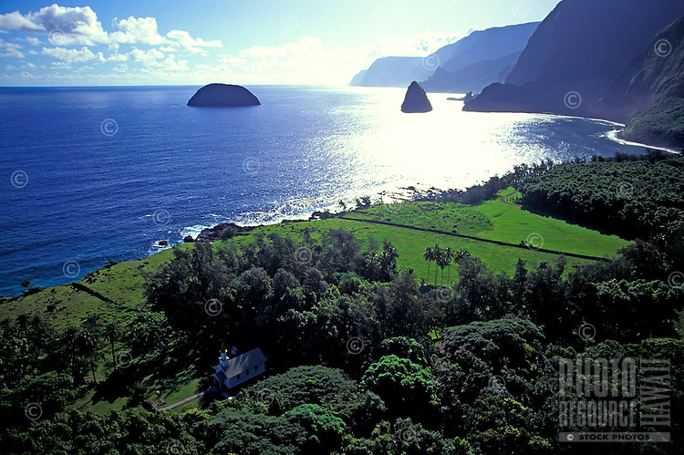 Aerial view of of the Kalawao area, on the Kalaupapa peninsula, with Siloama Church below, and Mokapu Island (left) and Okala Island (right) in the background