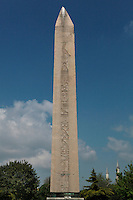 General view of Obelisk of Theodosius, 15th century BC, Hippodrome of Constantinople, Istanbul, Turkey. The Obelisk of Theodosius was originally erected at Karnak by Tutmoses III (1479-25 BC) and was transported to Alexandria by Constantius II in 357, and then by Theodosius to Constantinople in 390. Made from red granite it is inscribed with descriptions of Tutmoses' 1450 BC victory by the River Euphrates. Picture by Manuel Cohen.