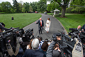 United States President Donald J. Trump, speaks to the media as he and First lady Melania Trump, prepare to depart the South Lawn of the White House in Washington, DC to deliver remarks at the Prescription Drug Abuse and Heroin Summit in Atlanta, Georgia on April 24, 2019.<br /> Credit: Ron Sachs / CNP