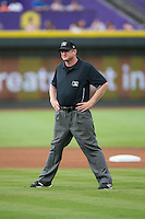 Umpire Howard Riddle handles the calls on the bases during the Carolina League game between the Myrtle Beach Pelicans and the Winston-Salem Dash at BB&T Ballpark on July 7, 2016 in Winston-Salem, North Carolina.  The Dash defeated the Pelicans 13-9.  (Brian Westerholt/Four Seam Images)