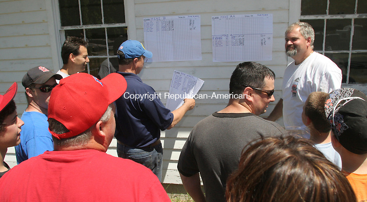 WINSTED, CT 19 JUNE 2010 - 0619JW06.jpg -- Parents and riders check the standings after the first race of the Laurel City Weekend sponsored by the Berkshire Trail Riders and Winsteds Aerial Ladder Company of the Winsted Fire Department Saturday afternoon. Jonathan Wilcox Republican-American
