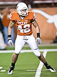 Texas Longhorns linebacker Dustin Earnest (42) warms up before the game between the Oklahoma State Cowboys and the University of Texas in Austin Texas Longhorns at the Daryl K. Royal- Texas Memorial Stadium in Austin, Texas. The Oklahoma State Cowboys defeated the Texas Longhorns 33 to 16.