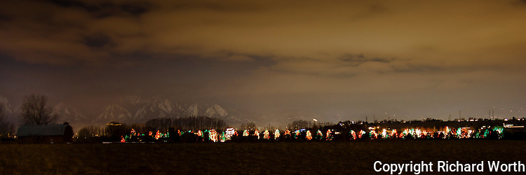 Near Denver a private Christmas tree display with the mighty Rocky Mountains as backdrop.