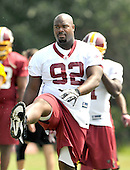 Ashburn, VA - August 4, 2009 -- Washington Redskins defensive tackle Albert Haynesworth (92) does a stretching exercise at the 2009 Washington Redskins training camp at Redskins Park in Ashburn Virginia on Monday, August 4, 2009.  Haynesworth is widely considered to be the best defensive lineman in the National Football League (NFL). .Credit: Ron Sachs / CNP