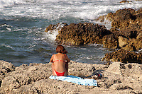 -Puglia, Otranto, la costa a sud della citt&agrave;, ragazza prende il sole<br /> <br /> - Apulia, Otranto, the coast south of the city, sunbathing girl
