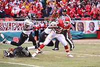 Chiefs running back Larry Johnson runs for 40 yards before he is stopped by Jacksonville Jaguars corner back Rashean Mathis with linebacker Clint Ingram closing in during the second quarter at Arrowhead Stadium in Kansas City, Missouri on December 31, 2006. The Chiefs won 35-30.