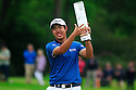 Byeong-Hun An of Korea poses with the trophy after the final round of the BMW PGA Championship played over the West Course at the Wentworth Club on 24th May 2015 in Virginia Water, Surrey, England. Picture Credit / Phil INGLIS