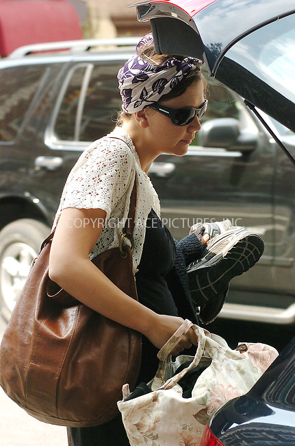 WWW.ACEPIXS.COM . . . . .  ....**EXCLUSIVE-FEE MSU BE AGREED BEFORE USE**....Pregnant Maggie Gyllenhaal and her partner Peter Sarsgaard, both looking tired, packed their car and left their West Village apartment.....Please byline: ALICE STONE-ACEPIXS.COM.... *** ***..Ace Pictures, Inc:  ..(212) 243-8787 or (646) 769 0430..e-mail: picturedesk@acepixs.com..web: http://www.acepixs.com