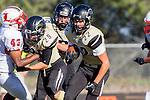 Palos Verdes, CA 09/27/13 - Rory Hubbard (Peninsula #22), Ryan Augello (Peninsula #29) and Justin Wallace (Lawndale #43) in action during the Lawndale vs Palos Verdes Peninsula Varsity football game at Peninsula High School.