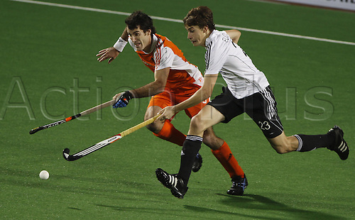 07.03.2010. Delhi,India. FIH World Cup Field Hockey.German German hockey player Florian Fuchs fights for the ball with Netherlands hockey player at the World Cup 2010 match at the Major Dhyan Chand Stadium in New Delhi Photo: Pankaj Nangia/Actionplus - Editorial Use