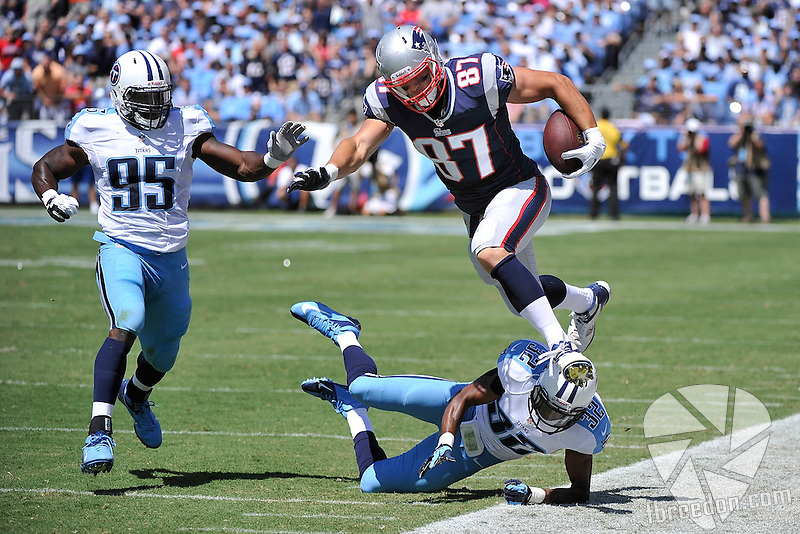 NASHVILLE, TN - SEPTEMBER 09:  Tight end Rob Gronkowski #87 of the New England Patriots is knocked out of bounds by Robert Johnson #32 of the Tennessee Titans at LP Field on September 9, 2012 in Nashville, Tennessee.  (Photo by Frederick Breedon/Getty Images) *** Local Caption *** Rob Gronkowski; Robert Johnson