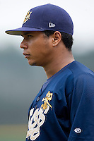 Injured Charleston RiverDogs outfielder Jose Tabata coaches first base in game action versus the Greensboro Grasshoppers at First Horizon Park in Greensboro, NC, Wednesday, August 9, 2006.