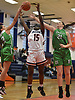 Chelsea Felix #15 of Manhasset, center, battles for a rebound along with Jessica Beriloff #2, left, and Demi Hecker #21 of Farmingdale during a non-league girls basketball game at Manhasset High School on Saturday, Dec. 8, 2018. Manhasset won by a score of 50-33.