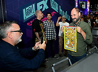 FOX FAN FAIR AT SAN DIEGO COMIC-CON© 2019: L-R: BOB'S BURGERS Cast Member Larry Murphy and Creator Loren Bouchard during the BOB'S BURGERS booth signing on Friday, July 19 at the FOX FAN FAIR AT SAN DIEGO COMIC-CON© 2019. CR: Alan Hess/FOX © 2019 FOX MEDIA LLC