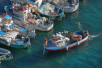 Fishing boats come and go in the little port beneath the hotel