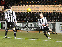 Gary irvine tries to keep the ball from Jordan Stewart in play in the St Mirren v Falkirk Scottish Professional Football League Ladbrokes Championship match played at the Paisley 2021 Stadium, Paisley on 1.3.16.