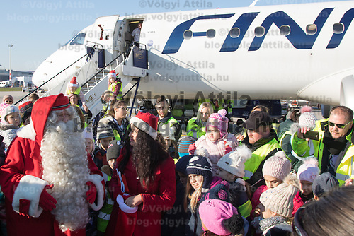 Finnish man dressed as Santa Claus named Joulupukki in Finland arrives to participate in the traditional Christmas celebrations in Budapest, Hungary on Dec. 1, 2017. ATTILA VOLGYI