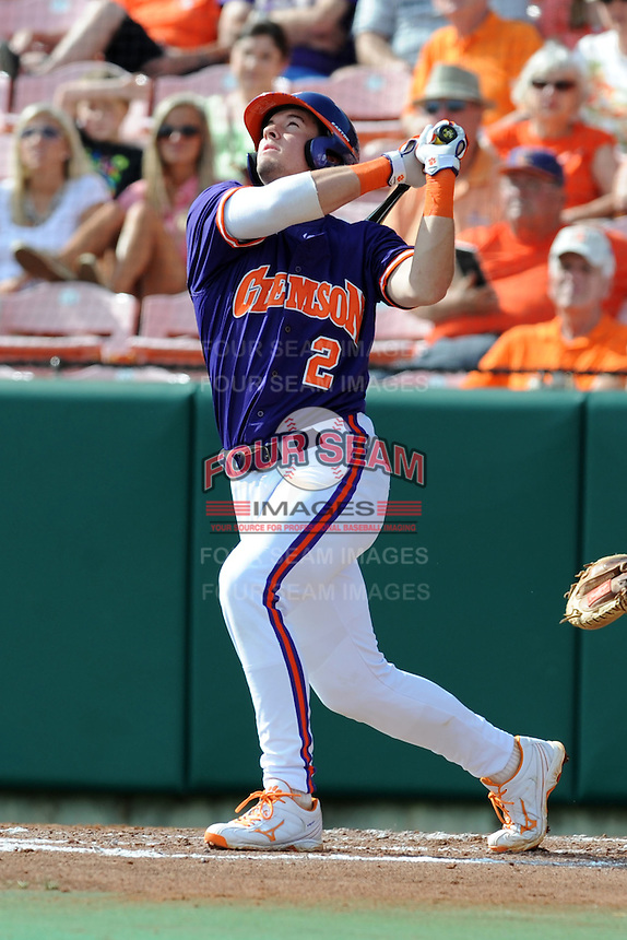 Shortstop Jason Stolz #2 swings at a pitch during a  game against the Miami Hurricanes at Doug Kingsmore Stadium on March 31, 2012 in Clemson, South Carolina. The Tigers won the game 3-1. (Tony Farlow/Four Seam Images).