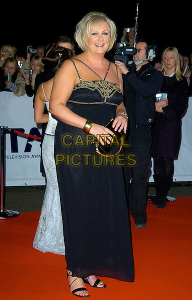 SUE CLEAVER.The National Television Awards, Royal Albert Hall, London, England..October 31st, 2007.TV NTA full length black dress gold detail clutch purse bag .CAP/CAN.© Can Nguyen/Capital Pictures