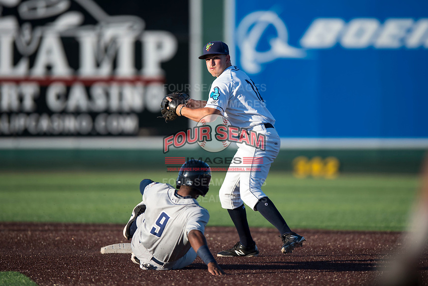 Everett AquaSox shortstop Ryne Ogren (16) prepares to make a throw to first base for a double play as Angel Solarte (9) slides into second base during a Northwest League game against the Tri-City Dust Devils at Everett Memorial Stadium on September 3, 2018 in Everett, Washington. The Everett AquaSox defeated the Tri-City Dust Devils by a score of 8-3. (Zachary Lucy/Four Seam Images)