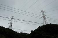 Landscape view of power transmission towers from the Onagawa nuclear power plant near the Mangokuura Sea following the 311 Tohoku Tsunami in Onagawa, Japan  © LAN