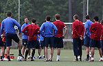 Head coach Bruce Arena (2nd from left) talks to the team on Saturday, May 20th, 2006 at SAS Soccer Park in Cary, North Carolina. The United States Men's National Soccer Team held a training session as part of their preparations for the upcoming 2006 FIFA World Cup Finals being held in Germany.