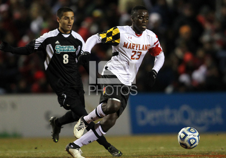 COLLEGE PARK, MD - NOVEMBER 25, 2012: Schillo Tshuma (23) of the University of Maryland moves away from Justin Portillo (8)of Coastal Carolina University during an NCAA championship third round match at Ludwig Field, in College Park, MD, on November 25. Maryland won 5-1.