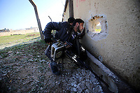Photographer: Rick Findler/Borderline News..17.01.13 Free Syirna Army soldiers have a closer look at Minnagh Military Airport. They are hoping to plan an offensive attack to take the airport from Assad control outside of Aleppo, Northern Syria.