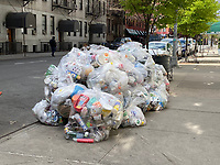 New York, New York City, in the time of Coronavirus. Garbage is not picked up as often and piles up in the city.