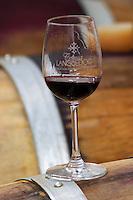 Glass embossed with Coteaux du Languedoc on a barrel. Domaine Mas Lumen in Gabian. Pezenas region. Languedoc. Barrel cellar. France. Europe.