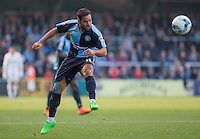 Sam Wood of Wycombe Wanderers hits the ball upfield during the Sky Bet League 2 match between Wycombe Wanderers and Northampton Town at Adams Park, High Wycombe, England on 3 October 2015. Photo by Andy Rowland.