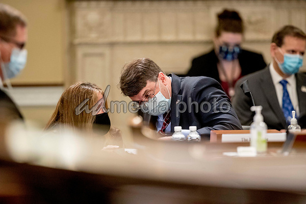United States Secretary of Veterans Affairs (VA) Robert Wilkie speaks to an aide as he appears before a US House Appropriations Subcommittee on Military Construction, Veterans Affairs, and Related Agencies hearing on Capitol Hill in Washington, Thursday, May 28, 2020, on the Department of Veterans Affairs response to COVID-19. <br /> Credit: Andrew Harnik / Pool via CNP/AdMedia