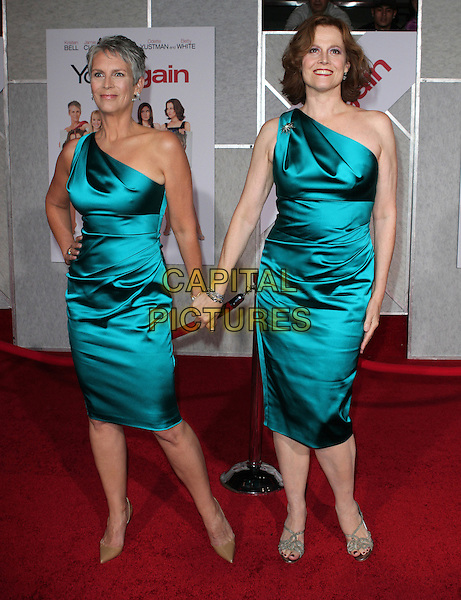 JAMIE LEE CURTIS & SIGOURNEY WEAVER.'You Again' Los Angeles Premiere held at El Capitan Theatre, Hollywood, CA, USA..September 22nd, 2010.full length silk satin one shoulder blue teal hand on hip holding hands dress beige nude pointy shoes matching sandals.CAP/ADM/FS.©Faye Sadou/AdMedia/Capital Pictures.